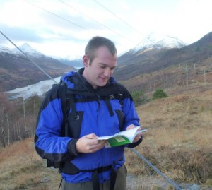 Thomas reading a map in Scotland